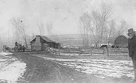 Pioneer cabin of John W. McBroom on Bear Creek; McBroom on the right. mid 1800s