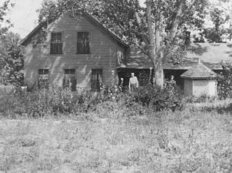 Col. and Mrs. Robert J. Spotswood in front of their ranch home west of Littleton, on the site of the present Columbine Country Club. about 1895