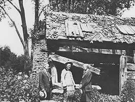 McBroom Cabin with F.S. Byers, Kit Carson, and E.M. Ammons, former governor of Colorado. 1924