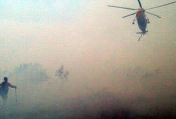 Helitcopter can be seen through the hazy smoke