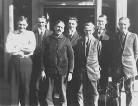 1916 Harry Knight; Fred Binner, assistant postmaster; Alex Johnson, R.R. carrier; Earl Downing; William Getschow, R.R. carrier; Edward H. Albertson, Postmaster; Ralph Duncan