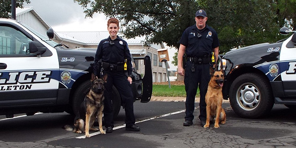 Officer Hanstrom with Zan, Officer Jones with Koda